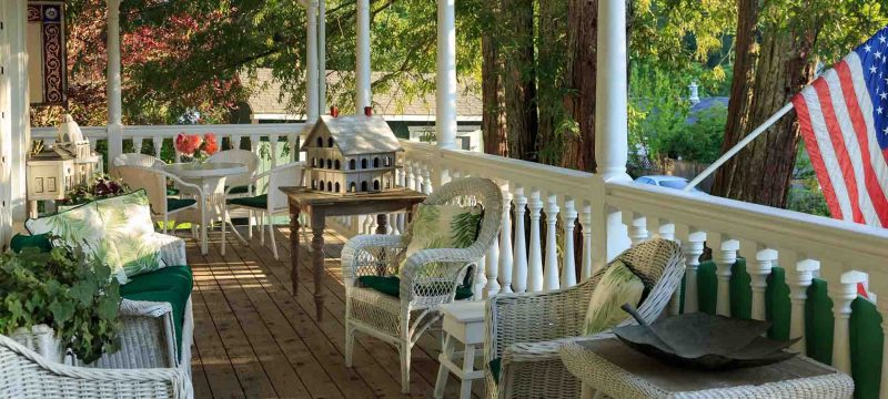 veranda with chairs and tables